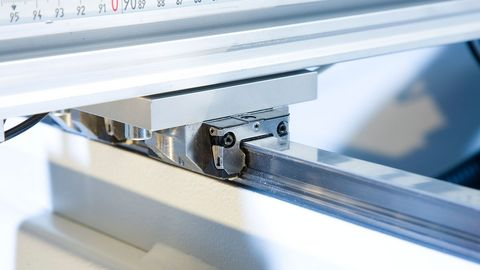 High precision ground linear guides with steel strip cover on all moving axes.